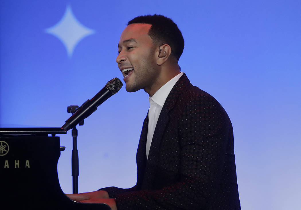 Musician John Legend performs at the My Brother's Keeper Alliance Summit in Oakland, Calif., Tuesday, Feb. 19, 2019. (AP Photo/Jeff Chiu)