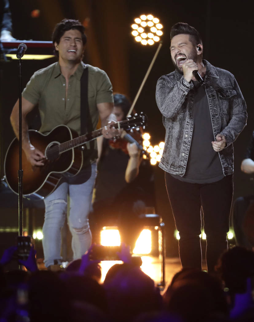 Dan Smyers, left, and Shay Mooney of musical group Dan + Shay, lead the 54th Academy of Country Music Awards with Chris Stapleton with six nominations each. The nominees were announced Wednesday, ...