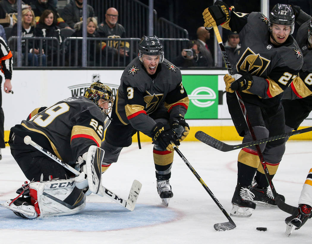 Vegas Golden Knights defenseman Brayden McNabb (3) moves the puck out from in front of the Vegas Golden Knights' goal during the second period of an NHL hockey game at T-Mobile Arena in Las Vegas, ...