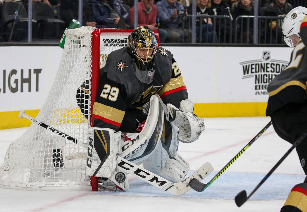 Vegas Golden Knights goaltender Marc-Andre Fleury (29) blocks a shot from the Boston Bruins during the second period of an NHL hockey game at T-Mobile Arena in Las Vegas, Wednesday, Feb. 20, 2019. ...