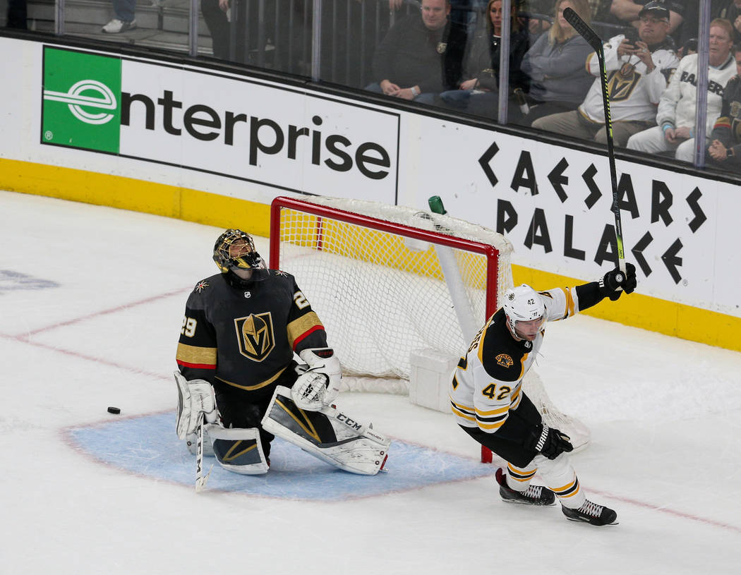 Boston Bruins right wing David Backes (42) scores against Vegas Golden Knights goaltender Marc-Andre Fleury (29) in a shootout during overtime of an NHL hockey game at T-Mobile Arena in Las Vegas, ...