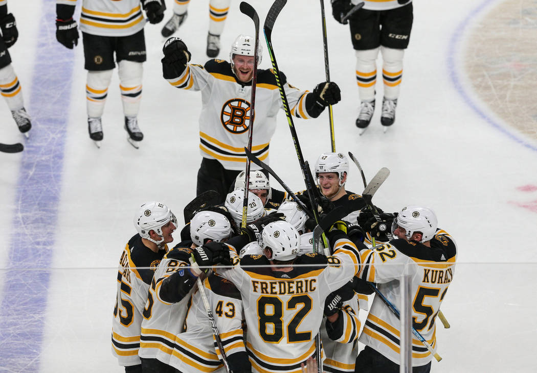 The Boston Bruins celebrate their win against the Vegas Golden Knights after Boston Bruins right wing David Backes (42) scores against Vegas Golden Knights goaltender Marc-Andre Fleury (29) in a s ...