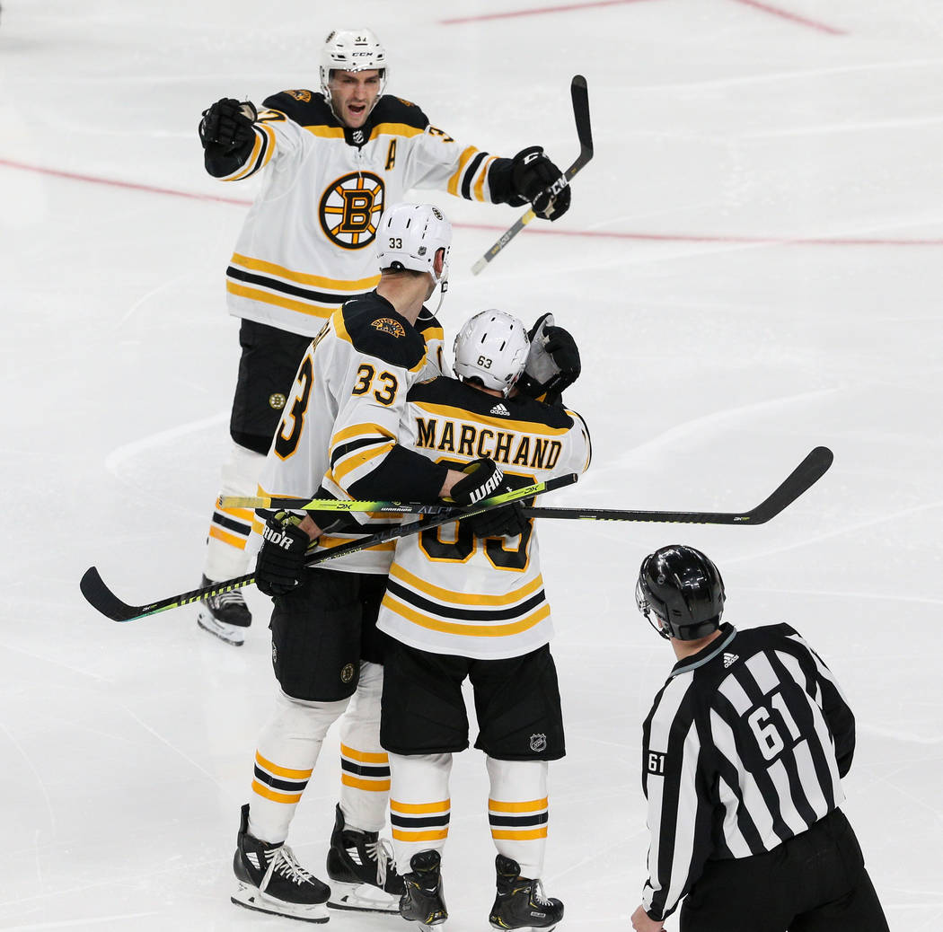 The Boston Bruins celebrate after Boston Bruins left wing Brad Marchand (63) scores against the Vegas Golden Knights during the third period of an NHL hockey game at T-Mobile Arena in Las Vegas, W ...