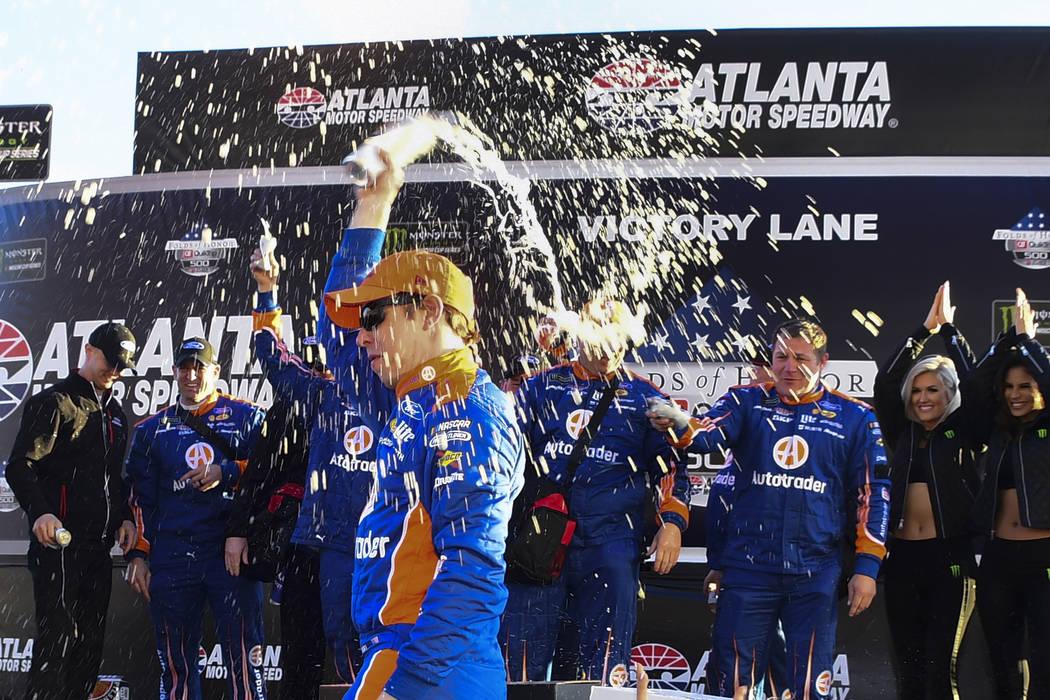 Brad Keselowski celebrates in victory lane after winning a Monster Energy NASCAR Cup Series auto race at Atlanta Motor Speedway, Sunday, Feb. 24, 2019, in Hampton, Ga. (AP Photo/Scott Cunningham)