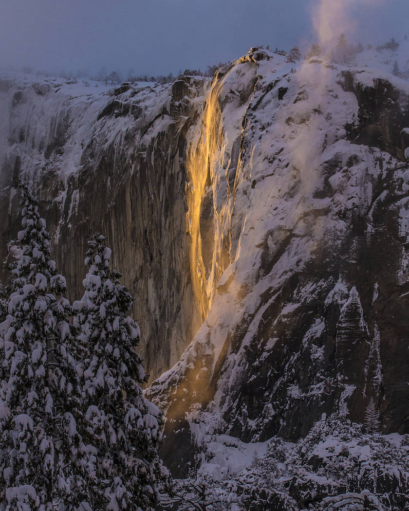 This Sunday, Feb. 17, 2019, photo released by Dakota Snider shows Horsetail Fall in Yosemite National Park, Calif. California's Yosemite National Park is again wowing visitors and photographers wi ...