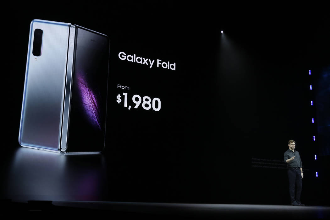 Justin Denison, SVP of Mobile Product Development, talks about the new Samsung Galaxy Fold smartphone during an event Wednesday, Feb. 20, 2019, in San Francisco. (Eric Risberg/AP)