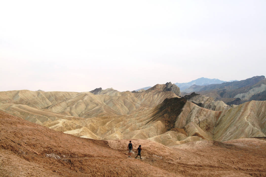 Hikers head across the badlands below Zabriskie Point in Death Valley National Park, California. (Deborah Wall/Las Vegas Review-Journal)
