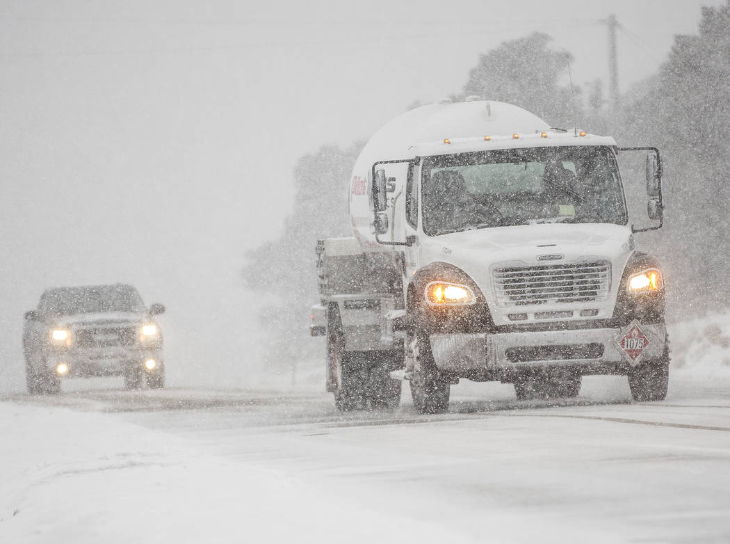 Vehicles drive cautiously through heavy snow at Mount Charleston on Wednesday, Feb. 20, 2019, outside Las Vegas. (Benjamin Hager Review-Journal) @BenjaminHphoto