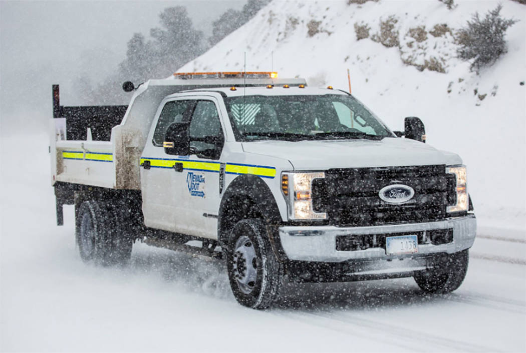 A vehicle from the Nevada Department of Transportation works in heavy snow to clear roads on Mount Charleston near Las Vegas on Wednesday, Feb. 20, 2019. (Benjamin Hager/Las Vegas Review-Journal)