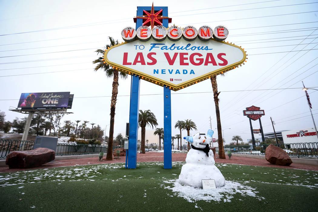 A snowman sits in front of the Welcome to Fabulous Las Vegas sign in Las Vegas, Thursday, Feb. 21, 2019. (Caroline Brehman/Las Vegas Review-Journal) @carolinebrehman