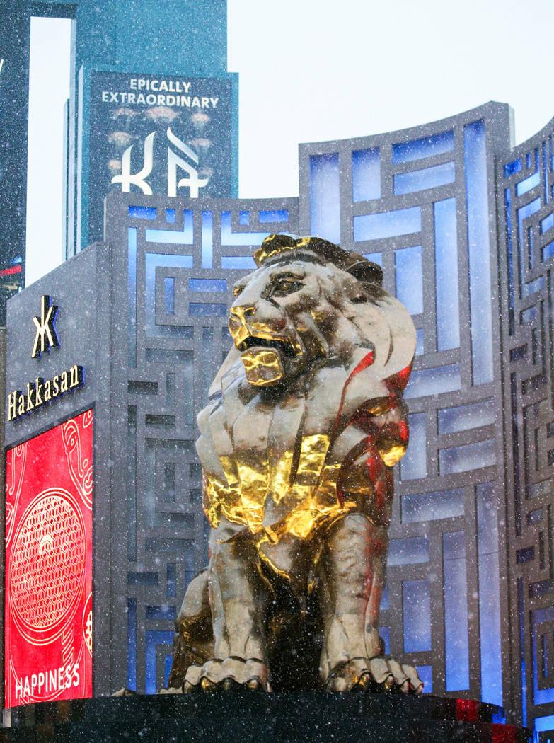 Snow falls on Leo, the lion statue outside of the MGM Grand hotel-casino, on the Strip in Las Vegas, Thursday, Feb. 21, 2019. (Caroline Brehman/Las Vegas Review-Journal) @carolinebrehman