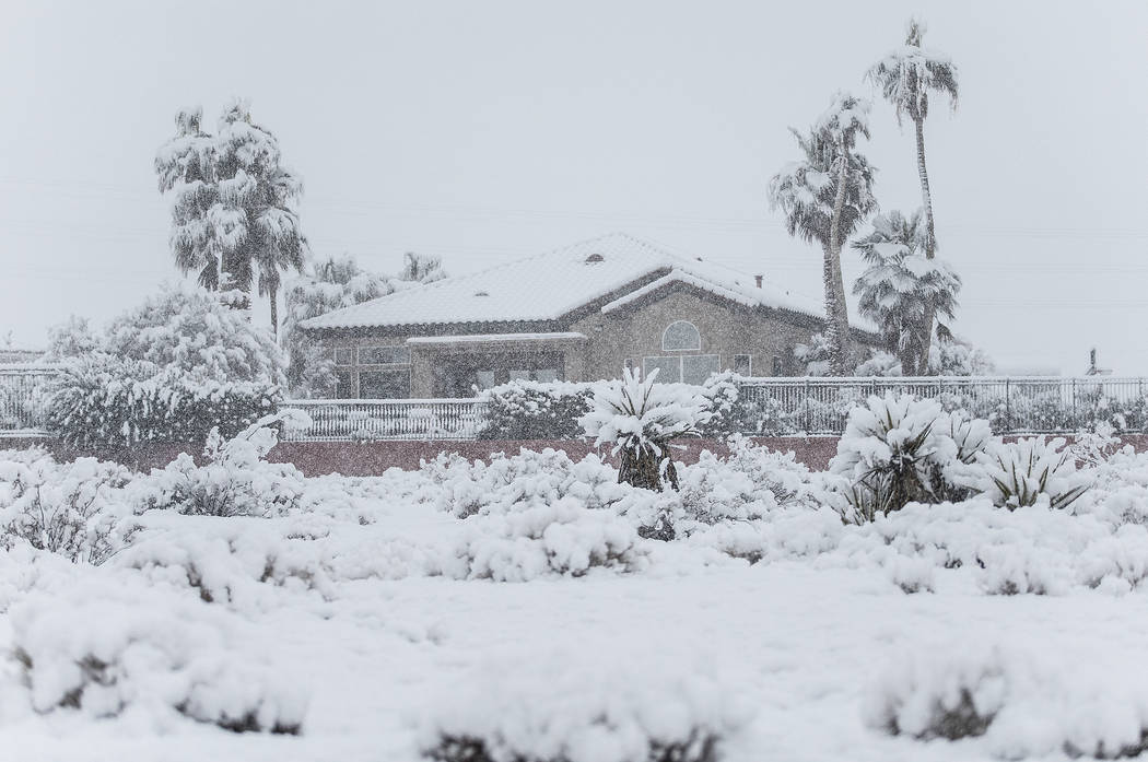 Homes in the northwest valley are covered in an early morning snow on Thursday, Feb. 21, 2019, in Las Vegas. (Benjamin Hager Review-Journal) @BenjaminHphoto