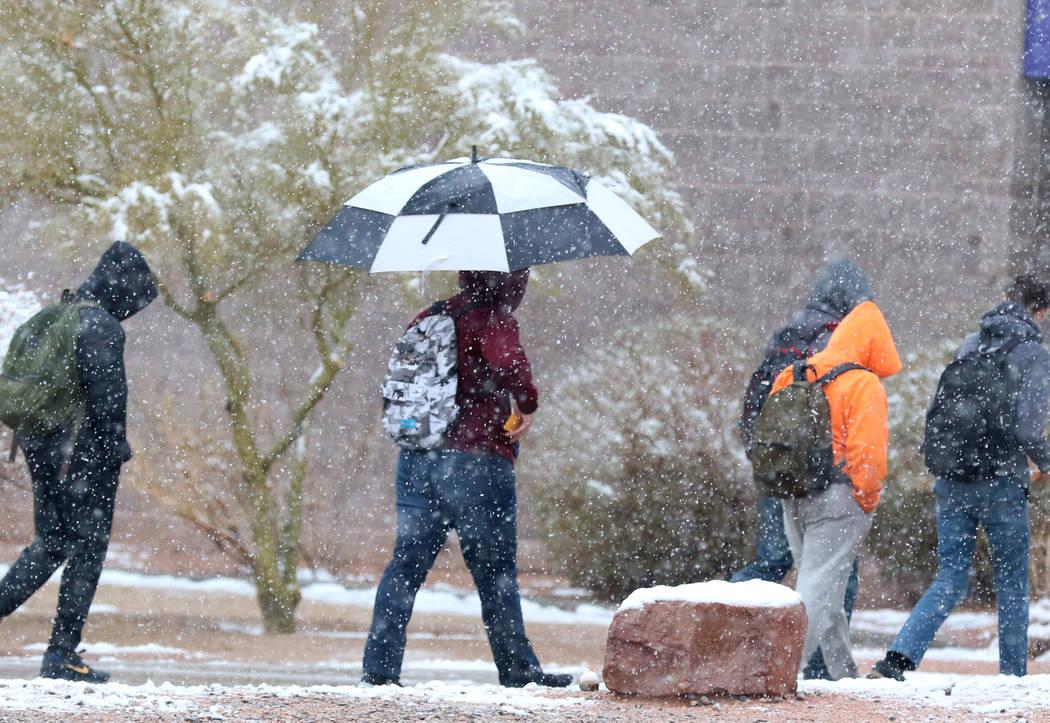 Durango High School students arrive at their school as snow continue to fall on Wednesday, Feb. 21, 2019. Bizuayehu Tesfaye Las Vegas Review-Journal @bizutesfaye