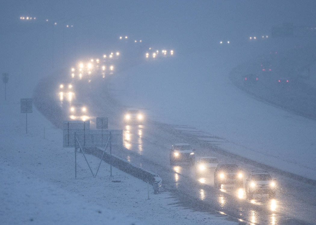 Traffic makes their way through early morning snow on the 215 Beltway southbound close to the Hualapai Way exit on Thursday, Feb. 21, 2019, in Las Vegas. (Benjamin Hager Review-Journal) @BenjaminH ...