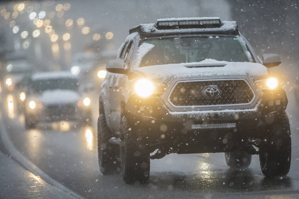 Traffic makes their way through early morning snow on U.S. Highway 95 southbound close to the Rancho Drive exit on Thursday, Feb. 21, 2019, in Las Vegas. (Benjamin Hager Review-Journal) @BenjaminH ...