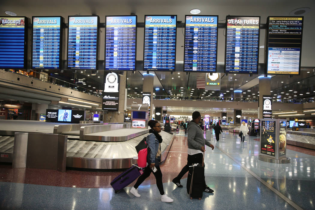 Flight departure screens at Terminal 1 show canceled and delayed flights to and from McCarran International Airport in Las Vegas, Thursday, Feb. 21, 2019. (Erik Verduzco/Las Vegas Review-Journal) ...