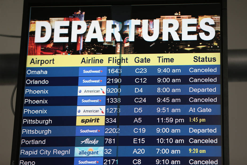 A flight departure screen shows canceled and delayed flights at McCarran International Airport Terminal 1 in Las Vegas, Thursday, Feb. 21, 2019. (Erik Verduzco/Las Vegas Review-Journal) @Erik_Verduzco