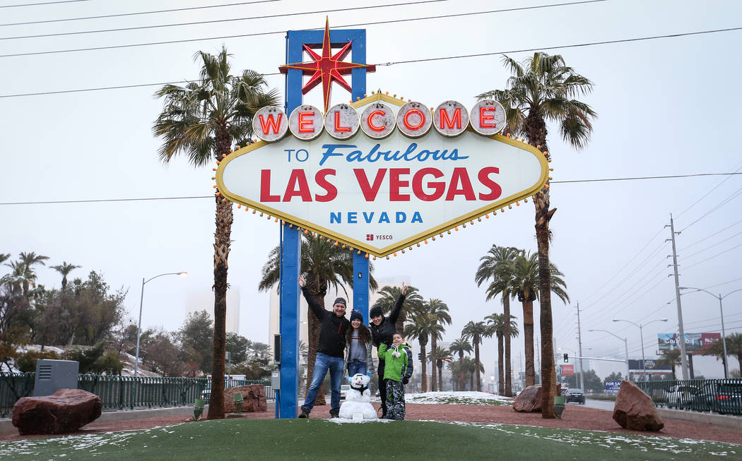 The Melendez family poses for a photograph in front of the Welcome to Fabulous Las Vegas sign in Las Vegas, Thursday, Feb. 21, 2019. (Caroline Brehman/Las Vegas Review-Journal) @carolinebrehman