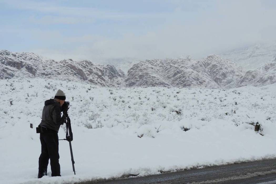 A photographer takes pictures of the snow at Red Rock on Thursday, Feb. 21, 2019. (Mat Luschek/Las Vegas Review-Journal)