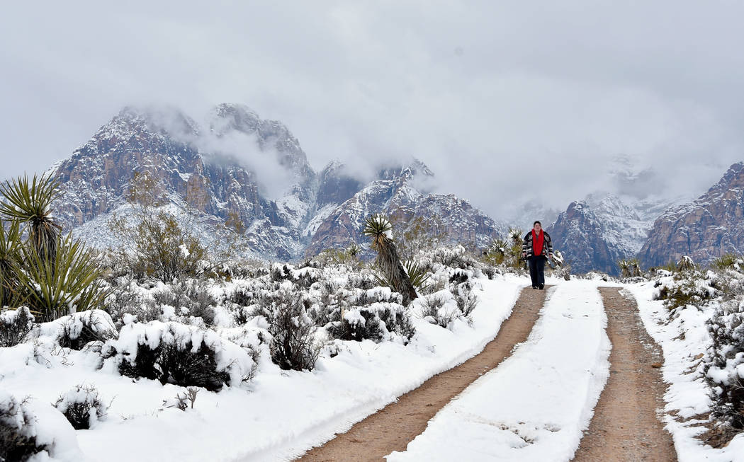 A woman hikes along a trail at Red Rock Canyon National Conservation Area Thursday, Feb. 21, 2019, in Las Vegas. Las Vegas experienced its most significant snowfall in over 10 years. (David Becker ...