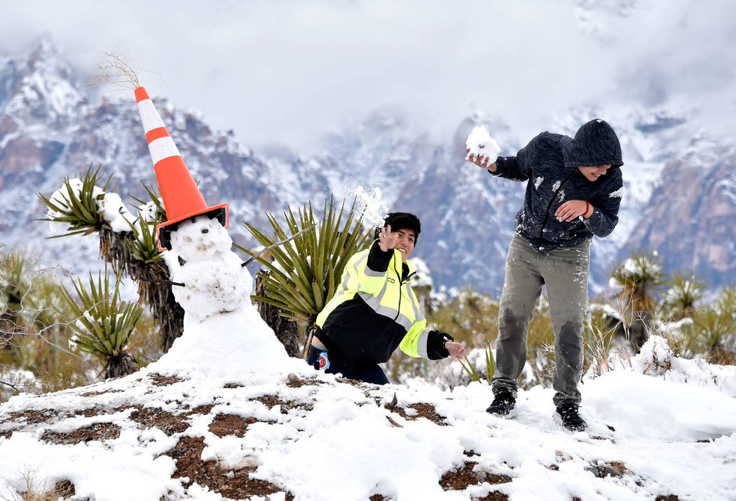 Oscar Saenz, left, tosses a snowball at his brother Edgar Saenz while their family visited Red Rock Canyon National Conservation Area Thursday, Feb. 21, 2019, in Las Vegas. Las Vegas experienced i ...