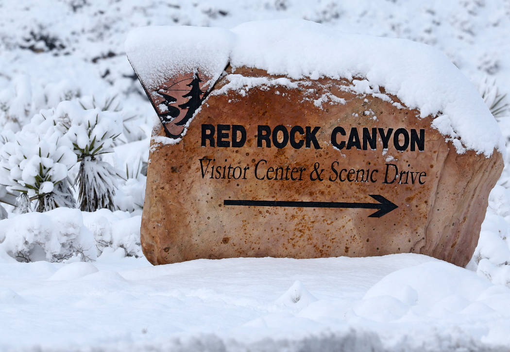 The Red Rock Canyon marker at Route 159 is covered in snow outside Las Vegas, Thursday, Feb. 21, 2019. (Heidi Fang /Las Vegas Review-Journal) @HeidiFang