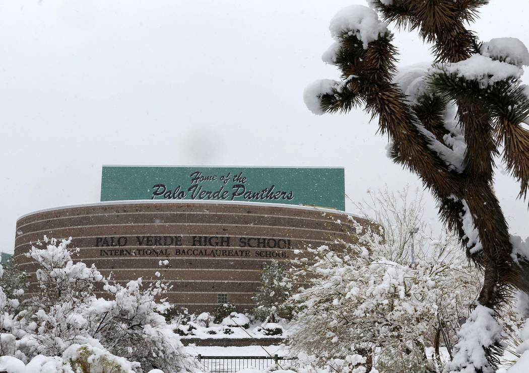 Snow falls in front of the entrance to Palo Verde High School in Las Vegas, Thursday, Feb. 21, 2019. (Heidi Fang /Las Vegas Review-Journal) @HeidiFang