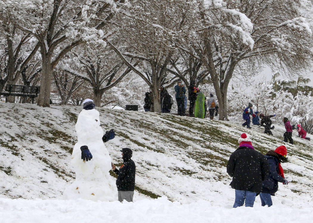 Las Vegans build snowmen and play in the snow at Arbors Tennis and Play Park in Summerlin in Las Vegas, Thursday, Feb. 21, 2019. (Heidi Fang /Las Vegas Review-Journal) @HeidiFang