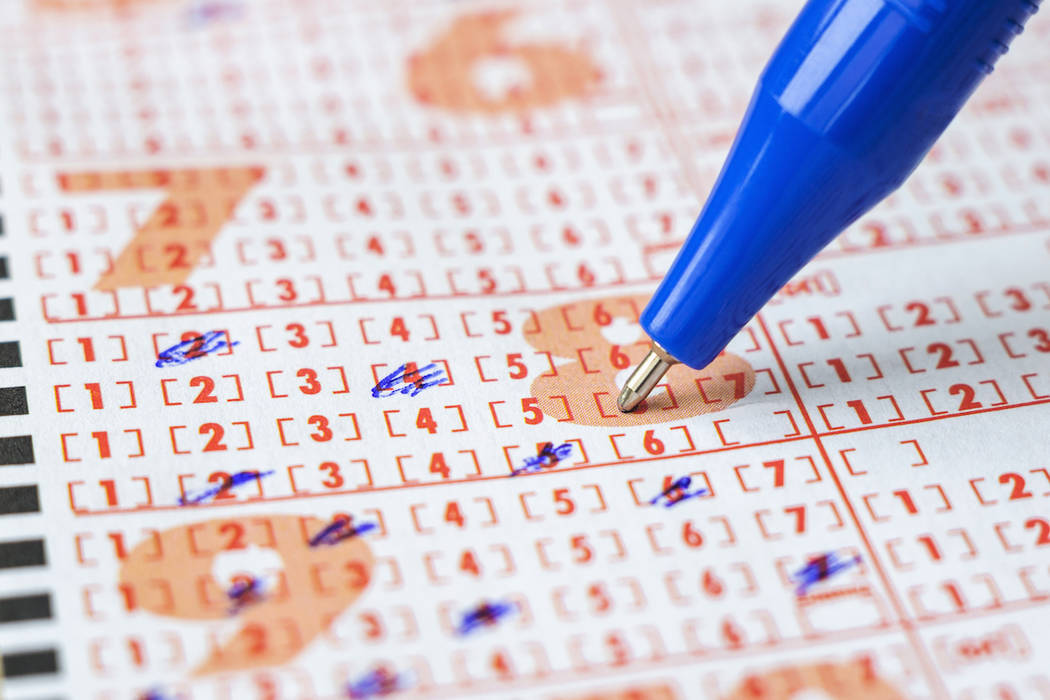 Lottery ticket and pen. (Getty Images)