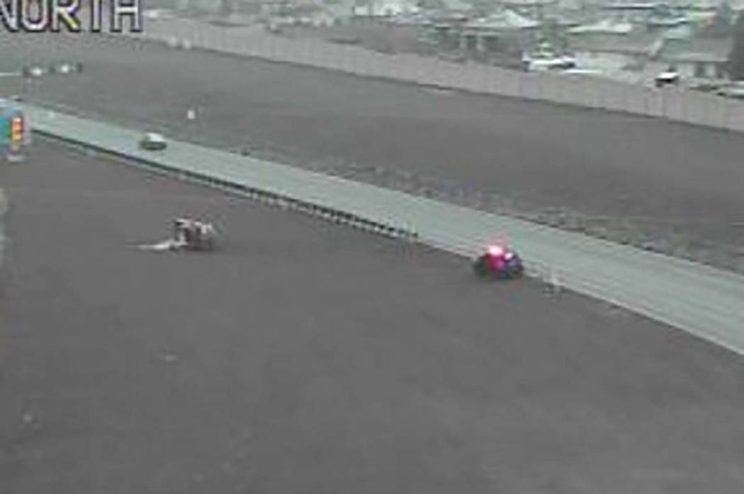 At least one person was injured in a rollover crash on U.S. 95 in Henderson. (RTC camera)
