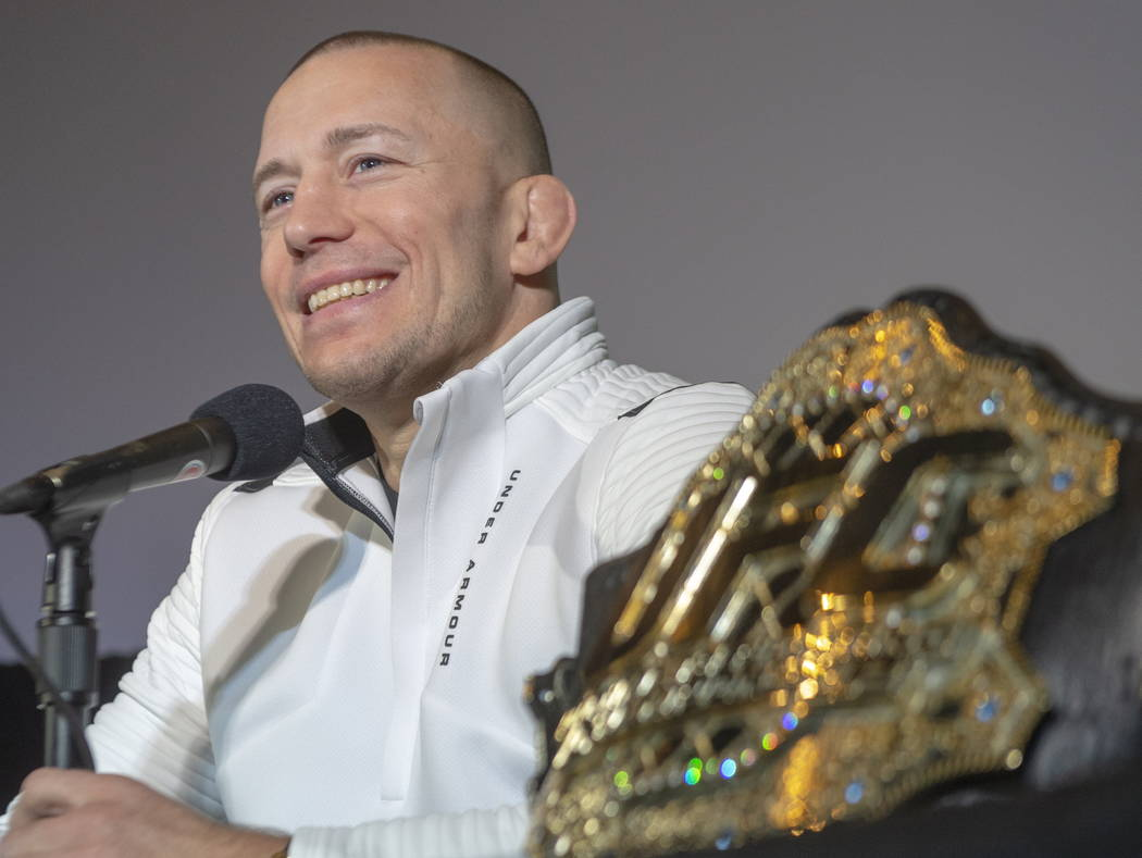 Canada's Georges St-Pierre announces his retirement from mixed martial arts during a press conference in Montreal, Thursday, Feb. 21, 2019. (Ryan Remiorz/The Canadian Press via AP)