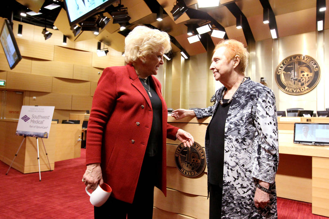 Las Vegas Mayor Carolyn Goodman, left, and Barbara Atkinson, the founding dean of the UNLV School of Medicine, mingle before Meet the New Face of Health Care in Southern Nevada town hall meeting a ...