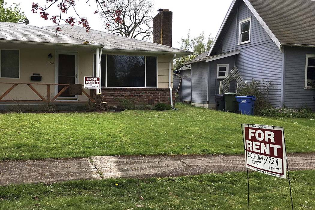 This April 22, 2017 file photo shows For Rent signs in front of a house in Salem, Ore. A committee of the Oregon House of Representatives debated a bill that would make Oregon the first state to i ...