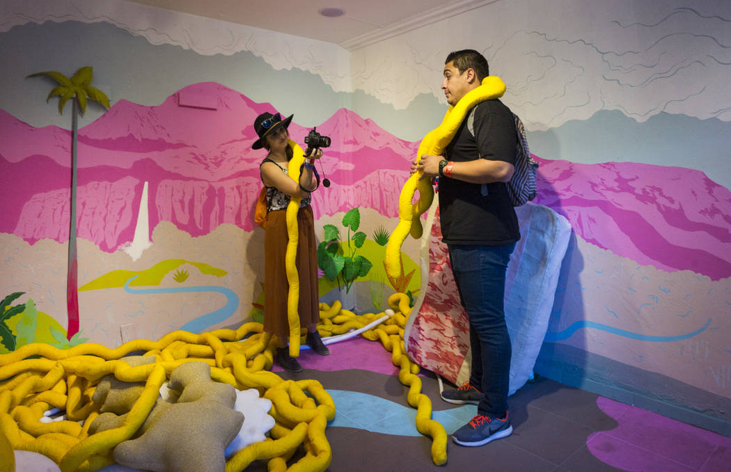 Katie Souther, left, takes a photo of Danny Cristales in an installation at the Art Motel by Meow Wolf during the first day of the Life is Beautiful festival in downtown in Las Vegas on Friday, Se ...