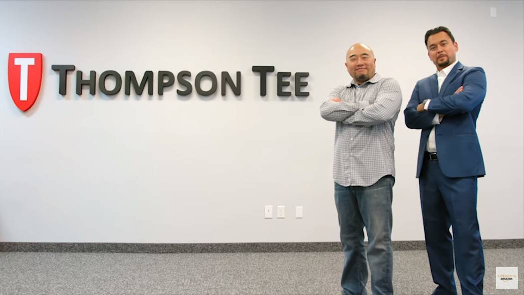 Co-founders Randy Choi, left, and Billy Thompson, right, pose in front of the Thompson Tee logo. (Courtesy)
