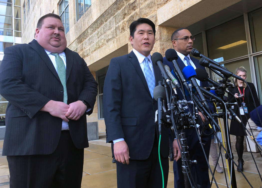 U.S. Attorney Robert Hur, center, of the District of Maryland, speaks as Art Walker, left, special agent from the Coast Guard investigative service, and Gordon Johnson, special agent in charge of ...