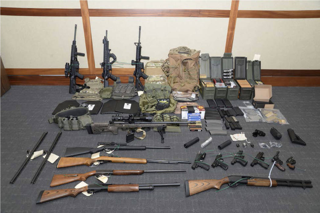 This image provided by the U.S. District Court in Maryland shows a photo of firearms and ammunition that was in the motion for detention pending trial in the case against Christopher Paul Hasson. ...