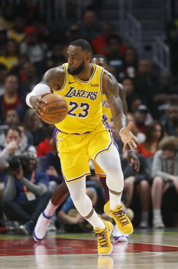 Los Angeles Lakers forward LeBron James (23) against the Atlanta Hawks during the second half of an NBA basketball game Tuesday, Feb. 12, 2019, in Atlanta. The Hawks won 117-113. (AP Photo/John Ba ...