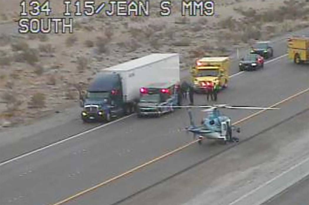 A helicopter landed on Interstate 15 near semi-truck, several ambulances and a firetruck near the Jean exit south of Las Vegas on Thursday, Feb. 21, 2019. RTC Cameras)