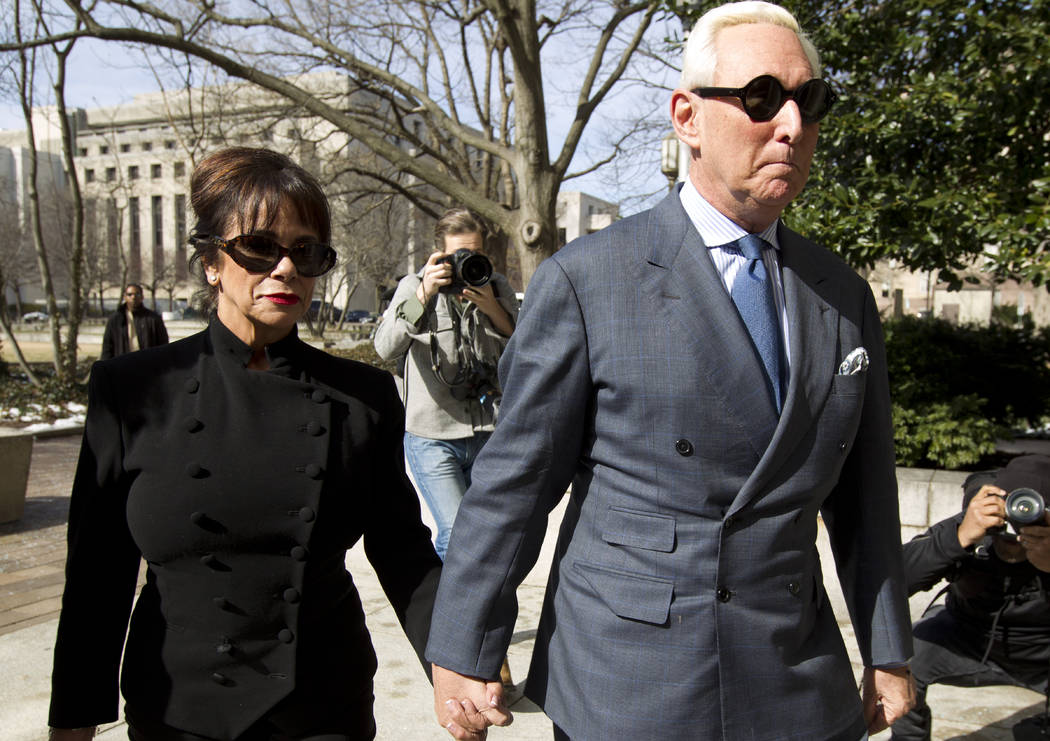 Former campaign adviser for President Donald Trump, Roger Stone accompanied by his wife Nydia Stone, left, arrives at federal court in Washington, Thursday, Feb. 21, 2019. Stone was ordered to app ...