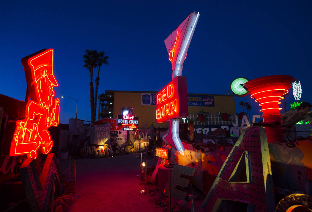 Neon signs light up the boneyard at the Neon Museum at dawn in Las Vegas on Monday, Jan. 28, 2019. (Chase Stevens/Las Vegas Review-Journal) @csstevensphoto