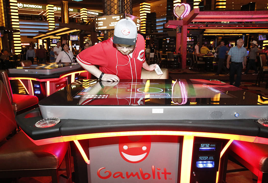 Aaron Hindel checks out the new gambling machine by skills-based company Gamblit at Planet Hollywood hotel-casino on Thursday, April 20, 2017, in Las Vegas. (Bizuayehu Tesfaye/Las Vegas Review-Jou ...