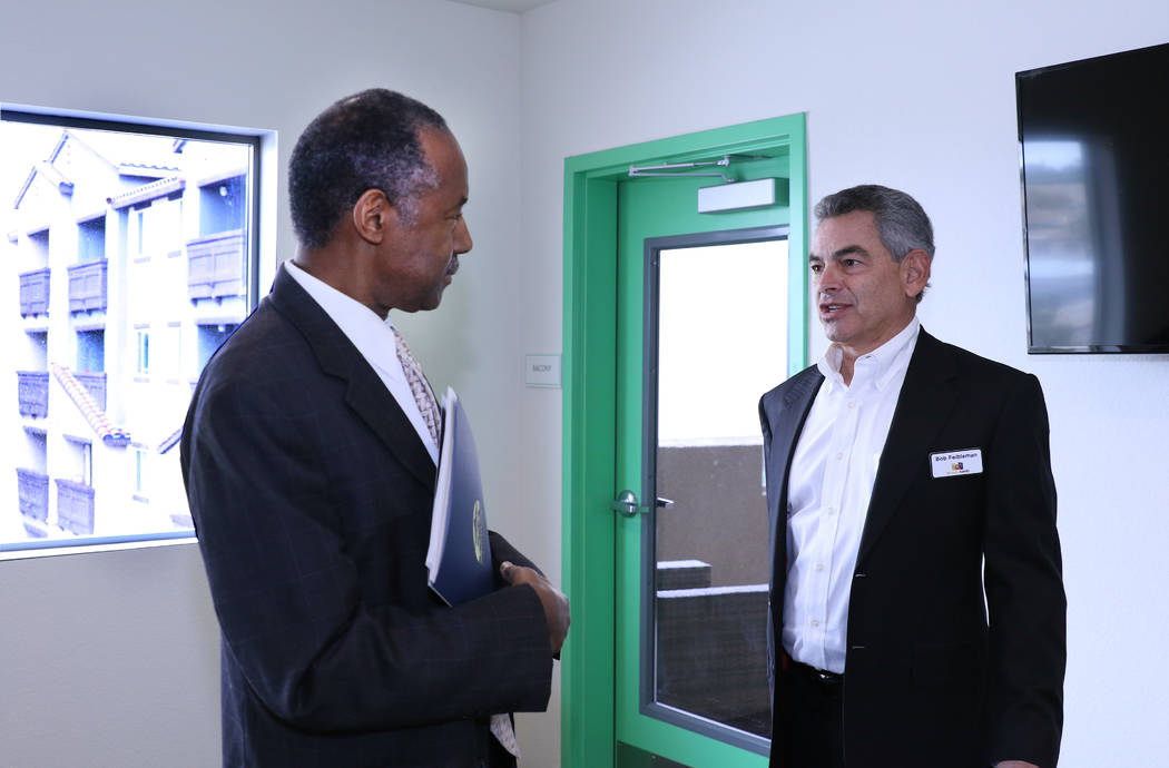Robert Feibleman, executive vice president HAND Construction Company, right, leads a tour of Rose Gardens, a housing development for seniors who need rental assistance, as U.S. Housing and Urban D ...
