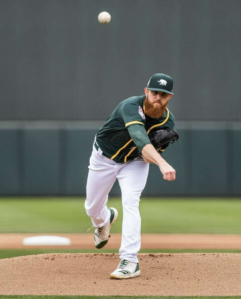 Oakland Athletics' Paul Blackburn throws against the Seattle Mariners during the first spring training baseball game of the season Thursday, Feb. 21, 2019, in Mesa, Ariz. (Dean Rutz/The Seattle Ti ...
