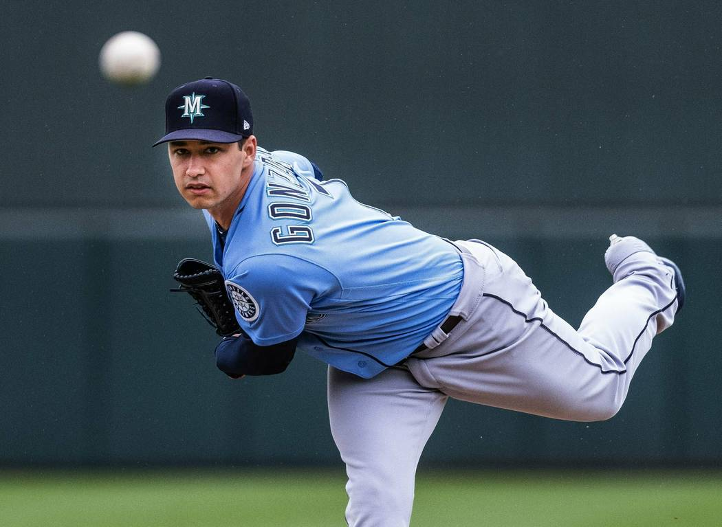 Seattle Mariners' Marco Gonzalez throws against the Oakland Athletics during the first spring training baseball game of the season Thursday, Feb. 21, 2019, in Mesa, Ariz. (Dean Rutz/The Seattle Ti ...