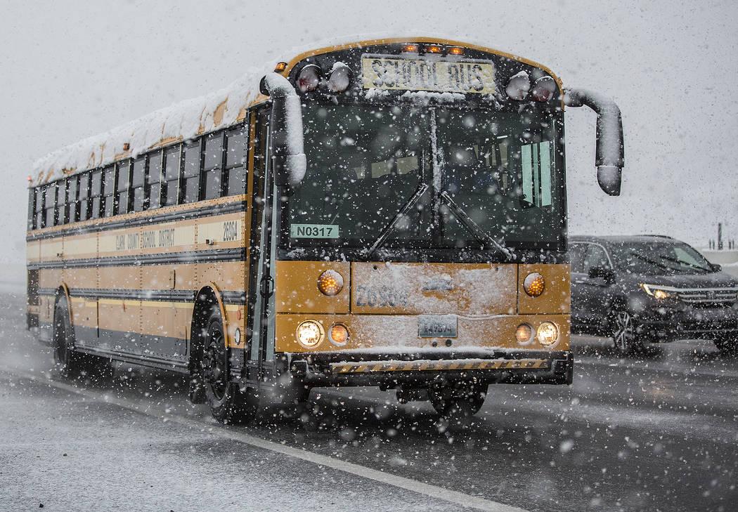 School buses make their way through heavy snow to Centennial High School on Thursday, Feb. 21, 2019, in Las Vegas. (Benjamin Hager Review-Journal) @BenjaminHphoto