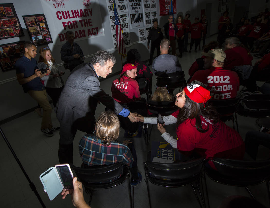 U.S. Sen. Sherrod Brown, D-Ohio, who is considering a run in the 2020 presidential race, greets Alicia Sosa during a meet and greet at Culinary Workers Union Local 226 in Las Vegas on Saturday, Fe ...