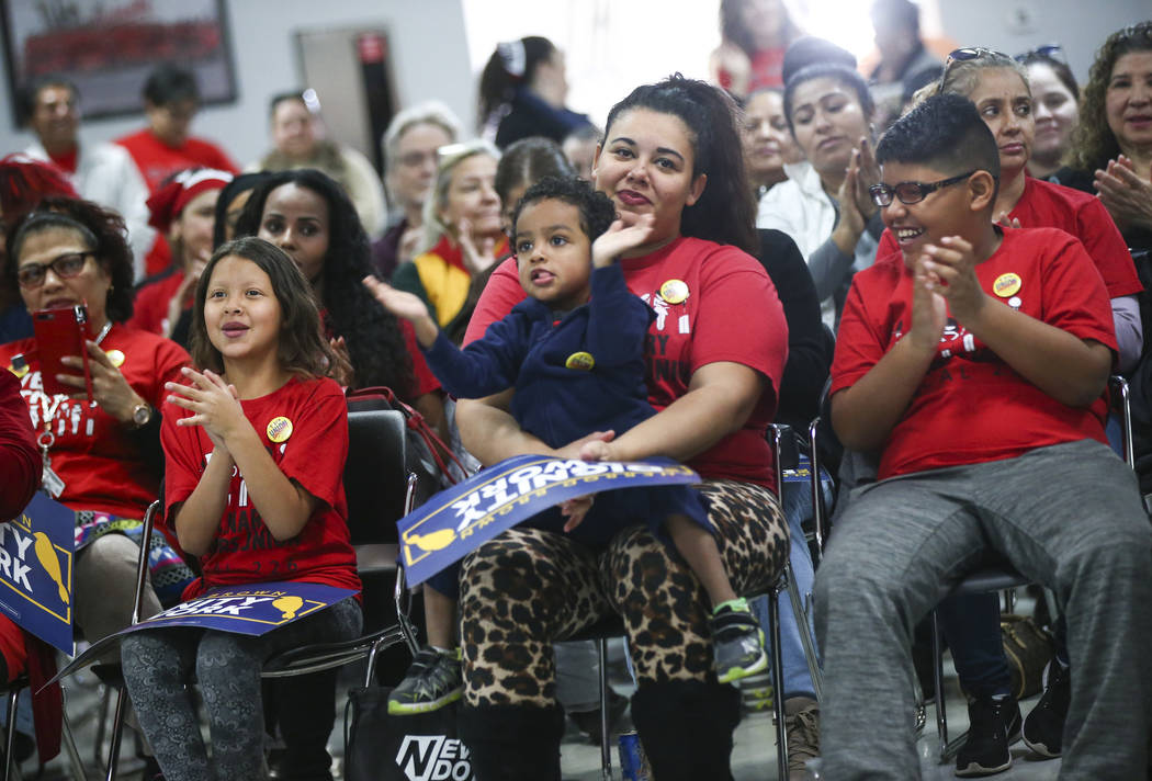 Nancy Rivas, center, holds her son Juan, 4, alongside her daughter, Itzel, 7, and son Jesus, 11, as they cheer before a visit by U.S. Sen. Sherrod Brown, D-Ohio, at a meet and greet event at Culin ...