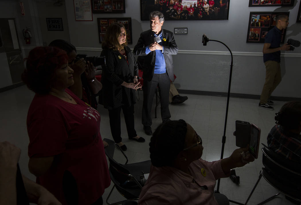U.S. Sen. Sherrod Brown, D-Ohio, center, stands next to his wife, Connie Schultz, before speaking at Culinary Workers Union Local 226 in Las Vegas on Saturday, Feb. 23, 2019. Brown is considering ...