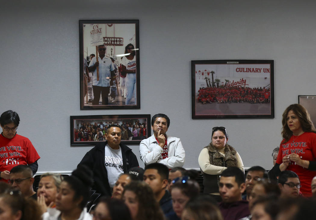 Attendees listen as Assemblyman Chris Brooks, D-Las Vegas, speaks before a visit by U.S. Sen. Sherrod Brown, D-Ohio, at Culinary Workers Union Local 226 in Las Vegas on Saturday, Feb. 23, 2019. (C ...